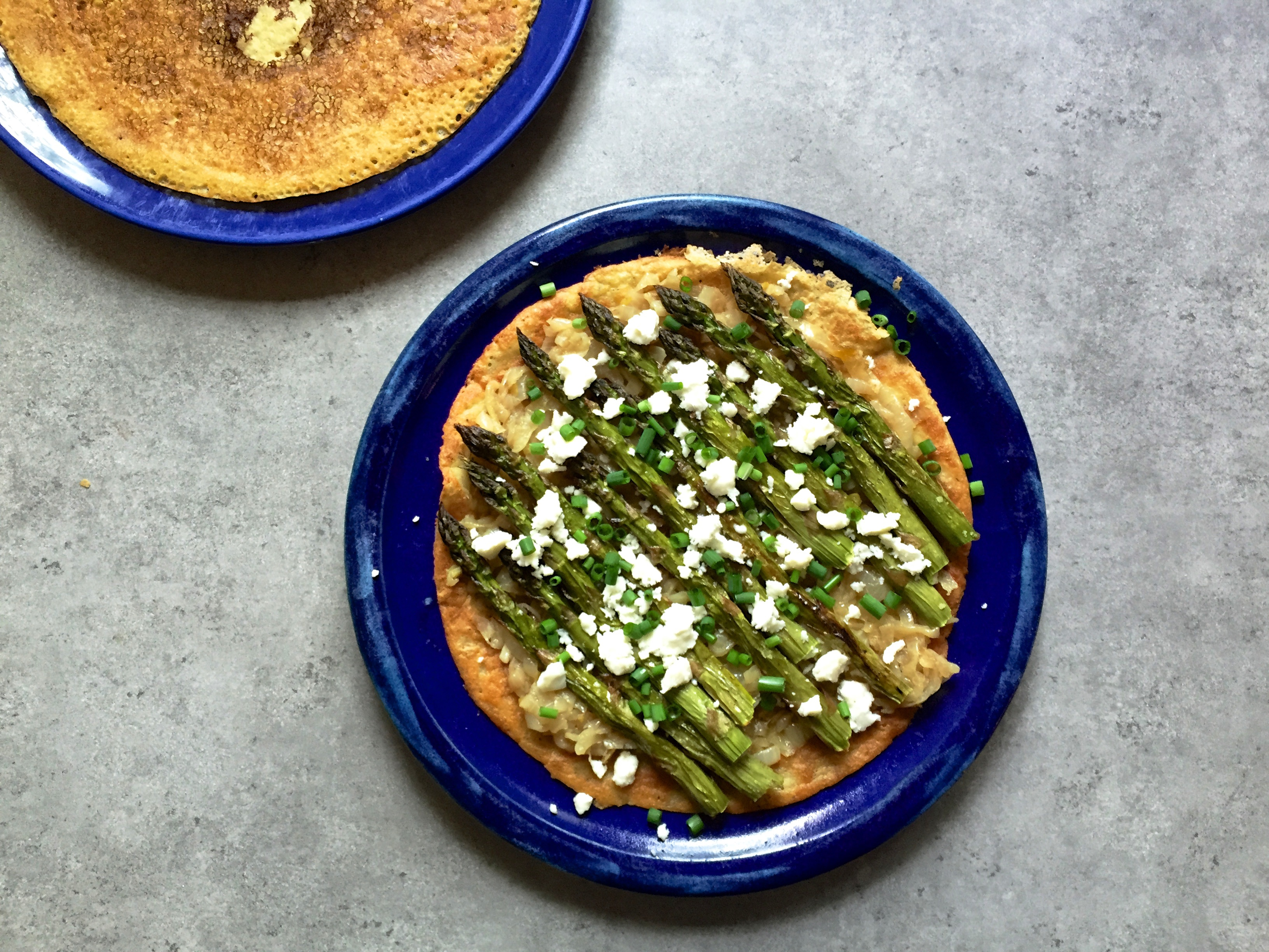 Socca (chickpea flour crepe) with asparagus, caramelized onion and feta