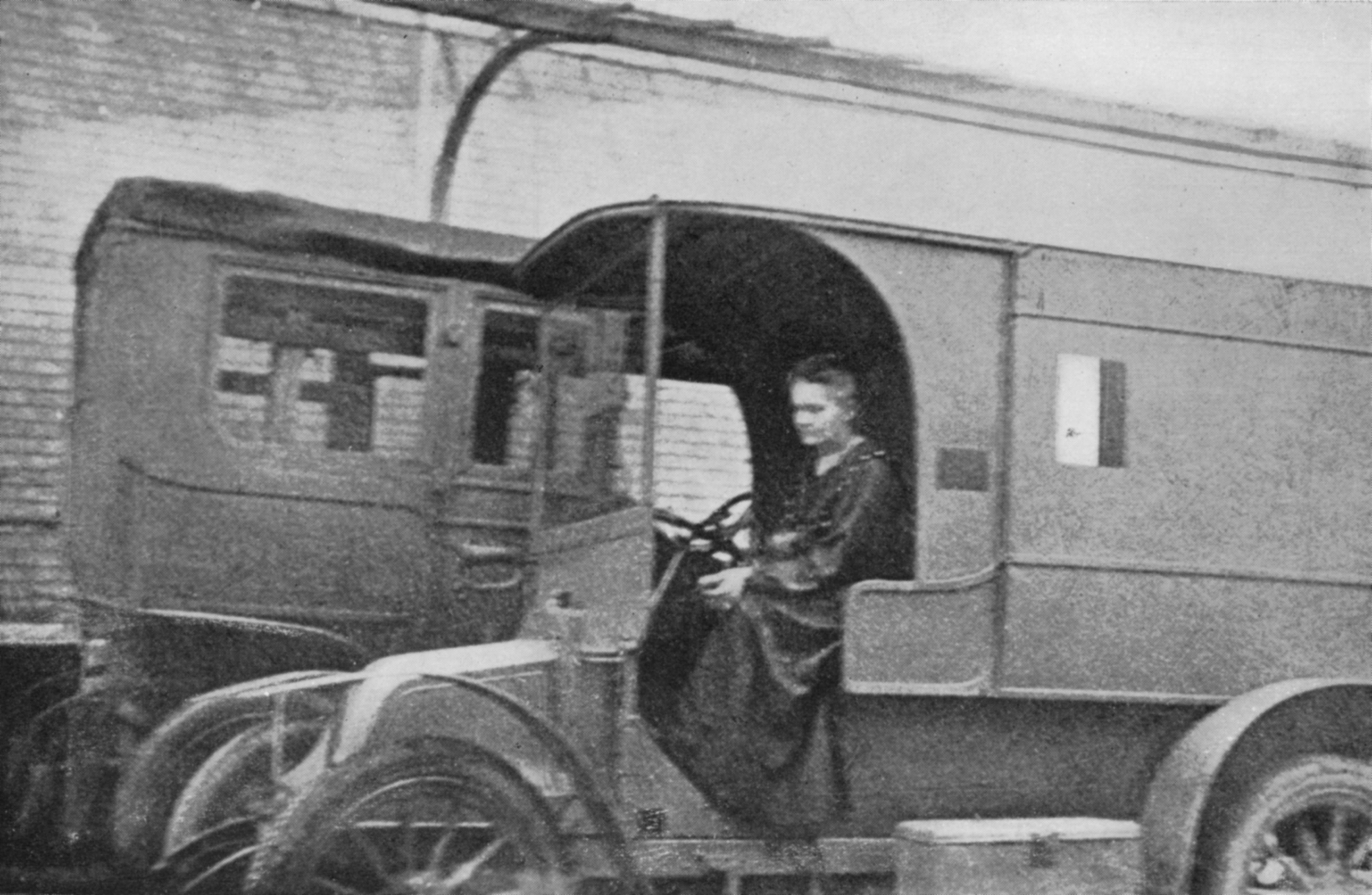 Physicist Marie Curie driving portable radiological unit