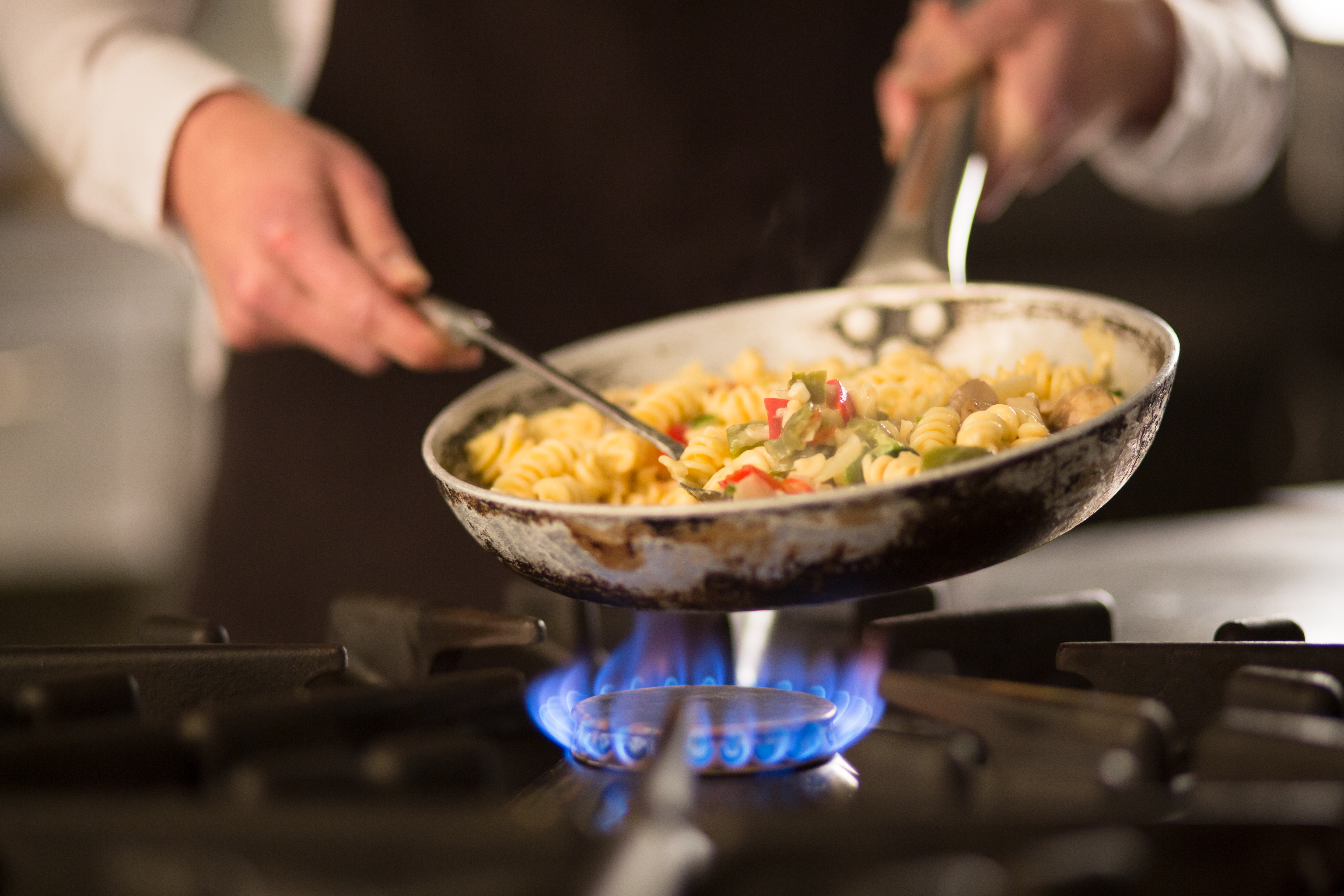 Pasta dish with vegetables on stove