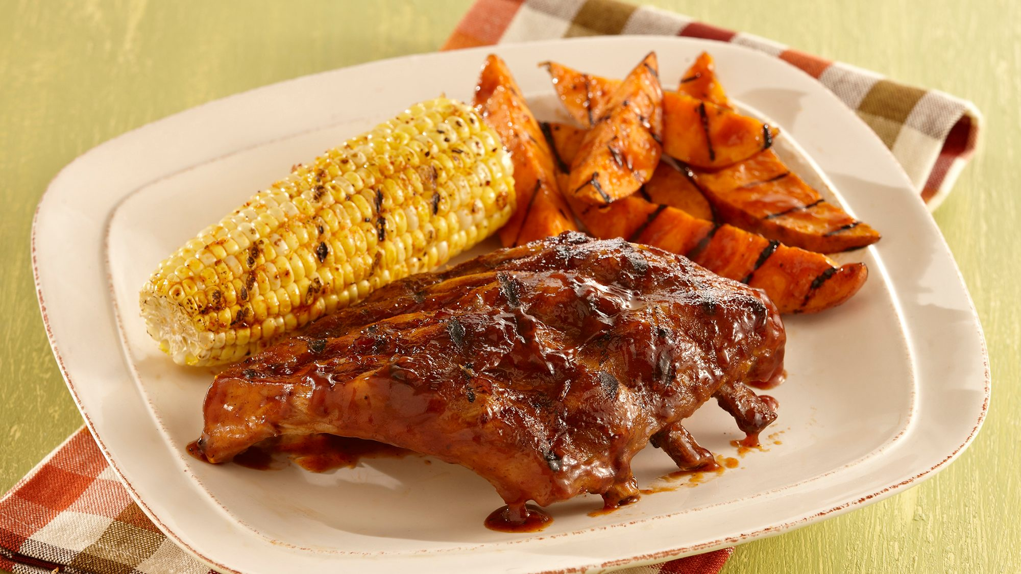 sweet-and-smoky-ribs-with-grilled-sweet-potatoes.jpg