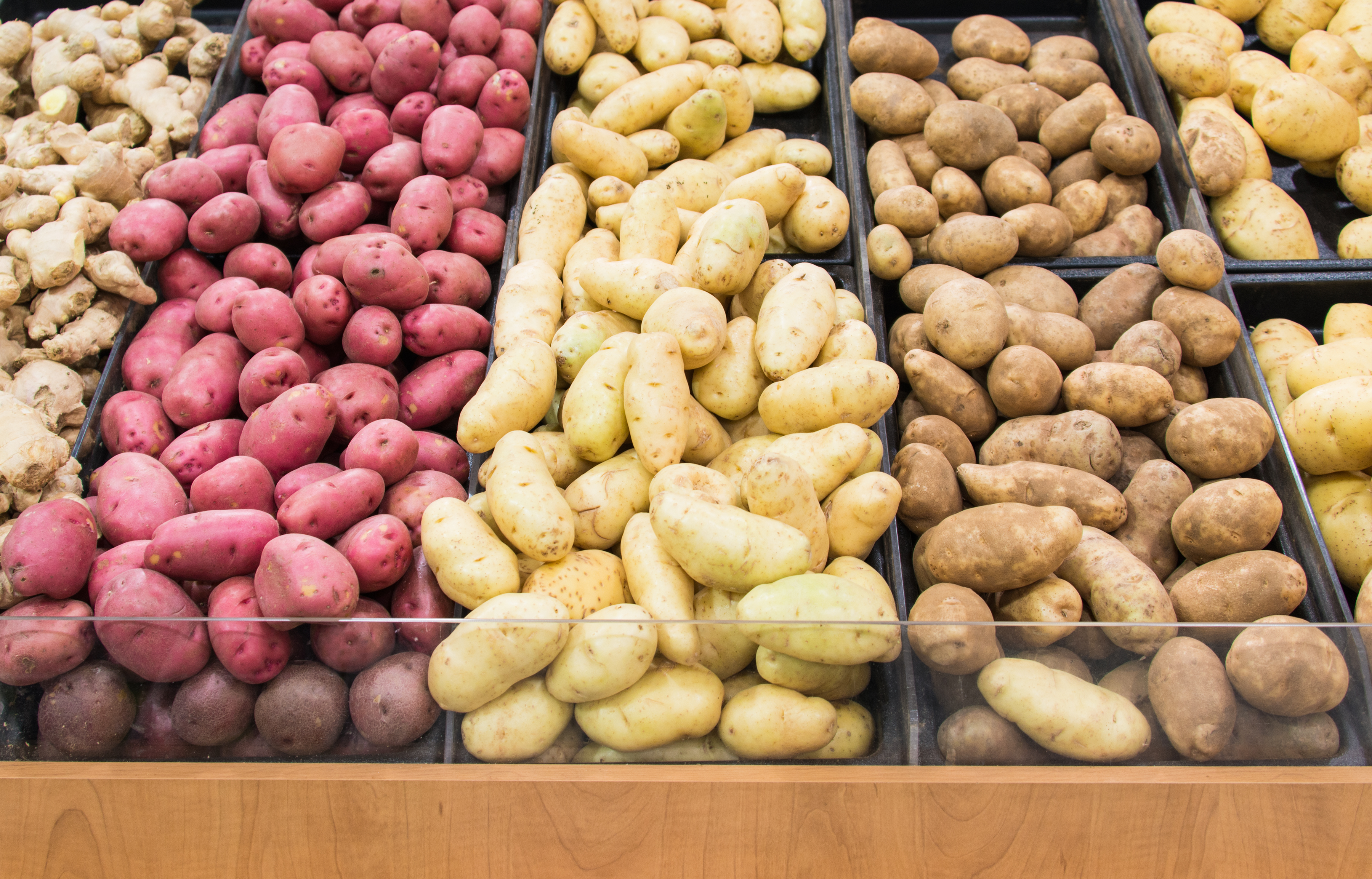 Different colors and varieties of potatoes in a grocery store