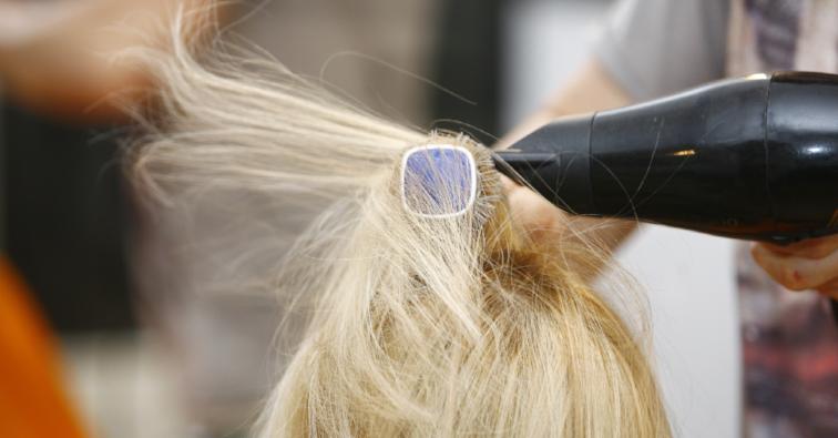 Hairstylist Drying Hair Blonde in Salon