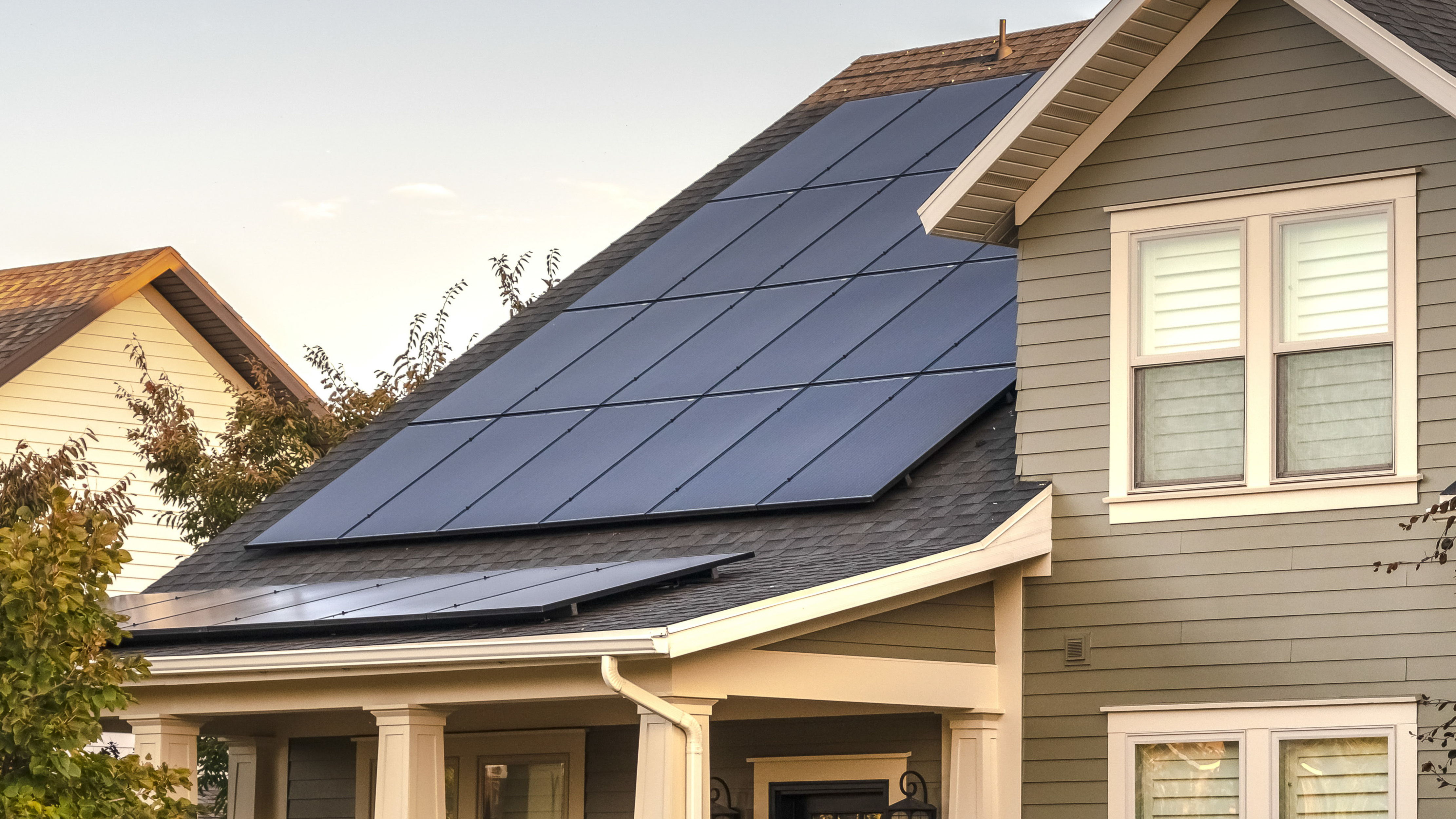 Panorama frame Solar photovoltaic panels on a house roof