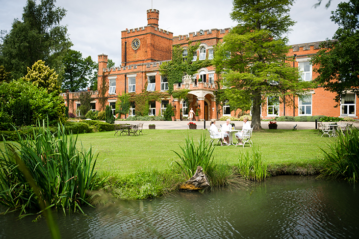 Ragdale Hall summer exterior with guests hr.jpg