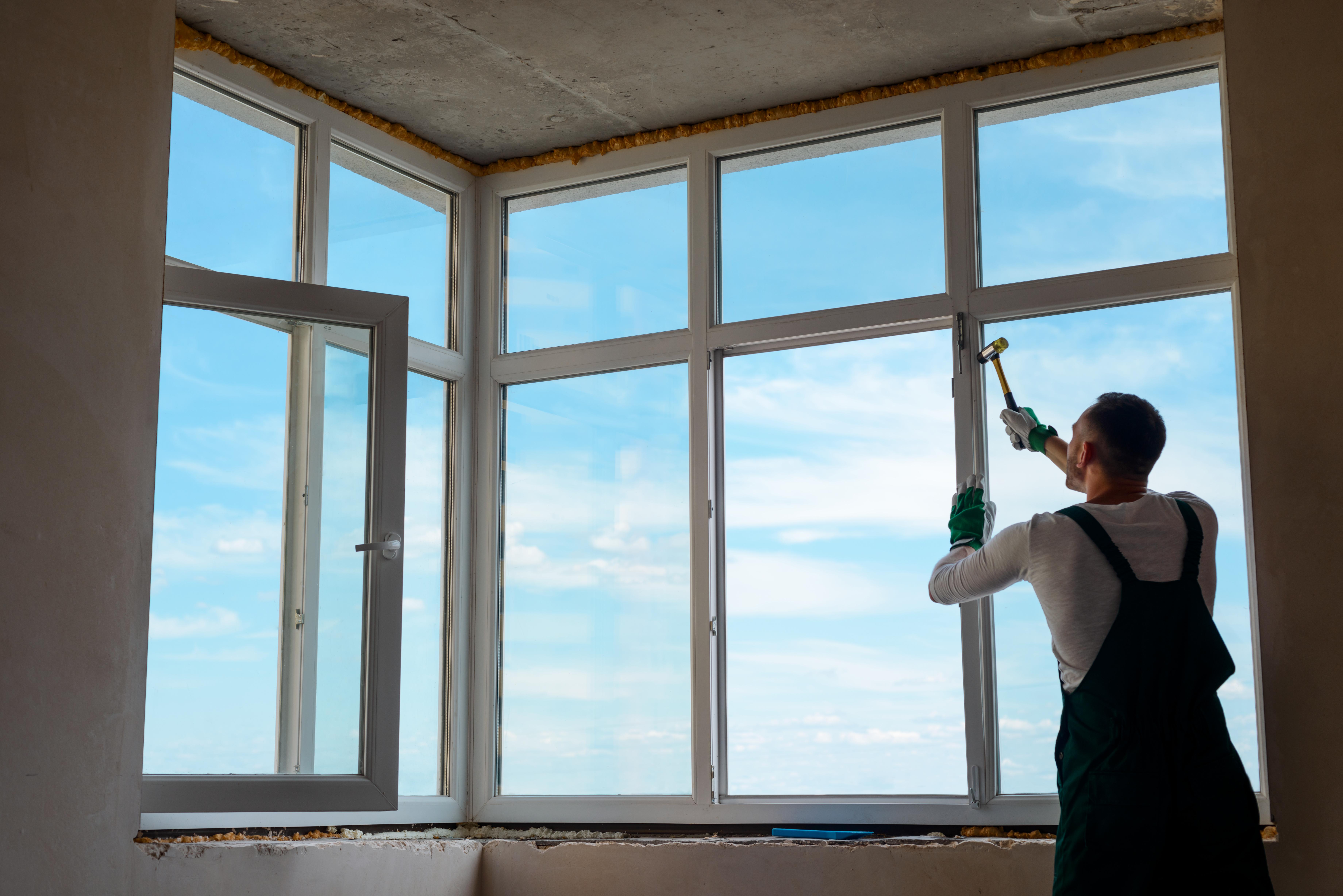 Builder is installing a window.