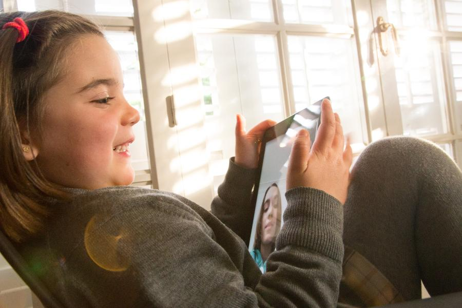Telecommuting parents seek out virtual babysitting—here's how it works