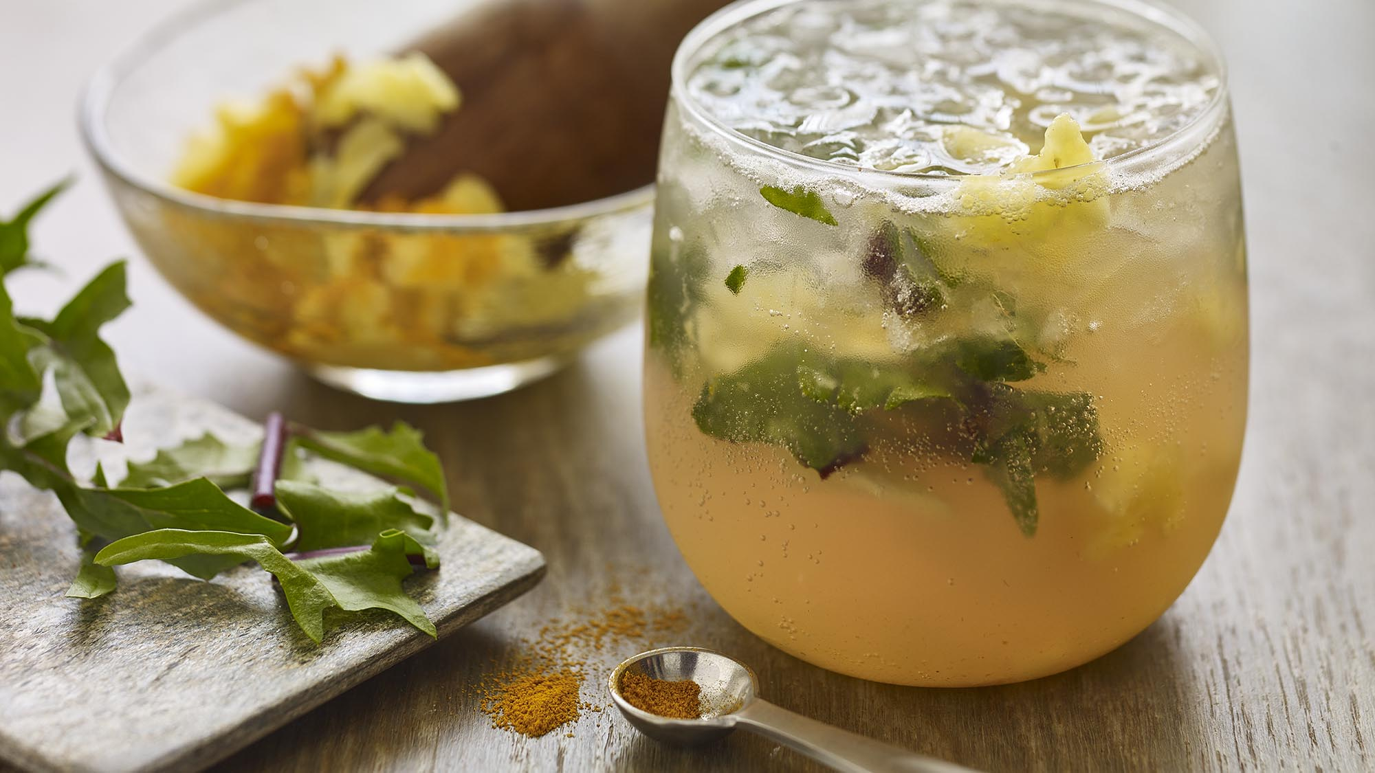 McCormick Pineapple Turmeric Mocktail with Muddled Dandelion Greens