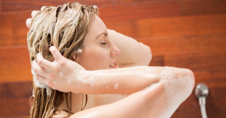 Beautiful woman washing her hair