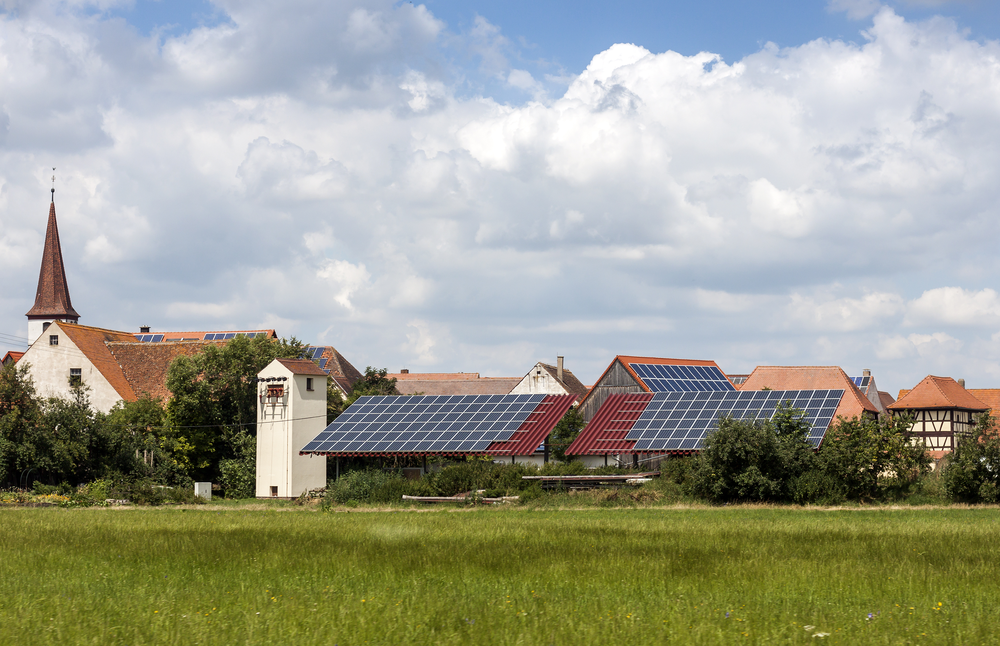 Solar powered homes in a rural village in Germany. Solar panels on roof as alternative energy source.