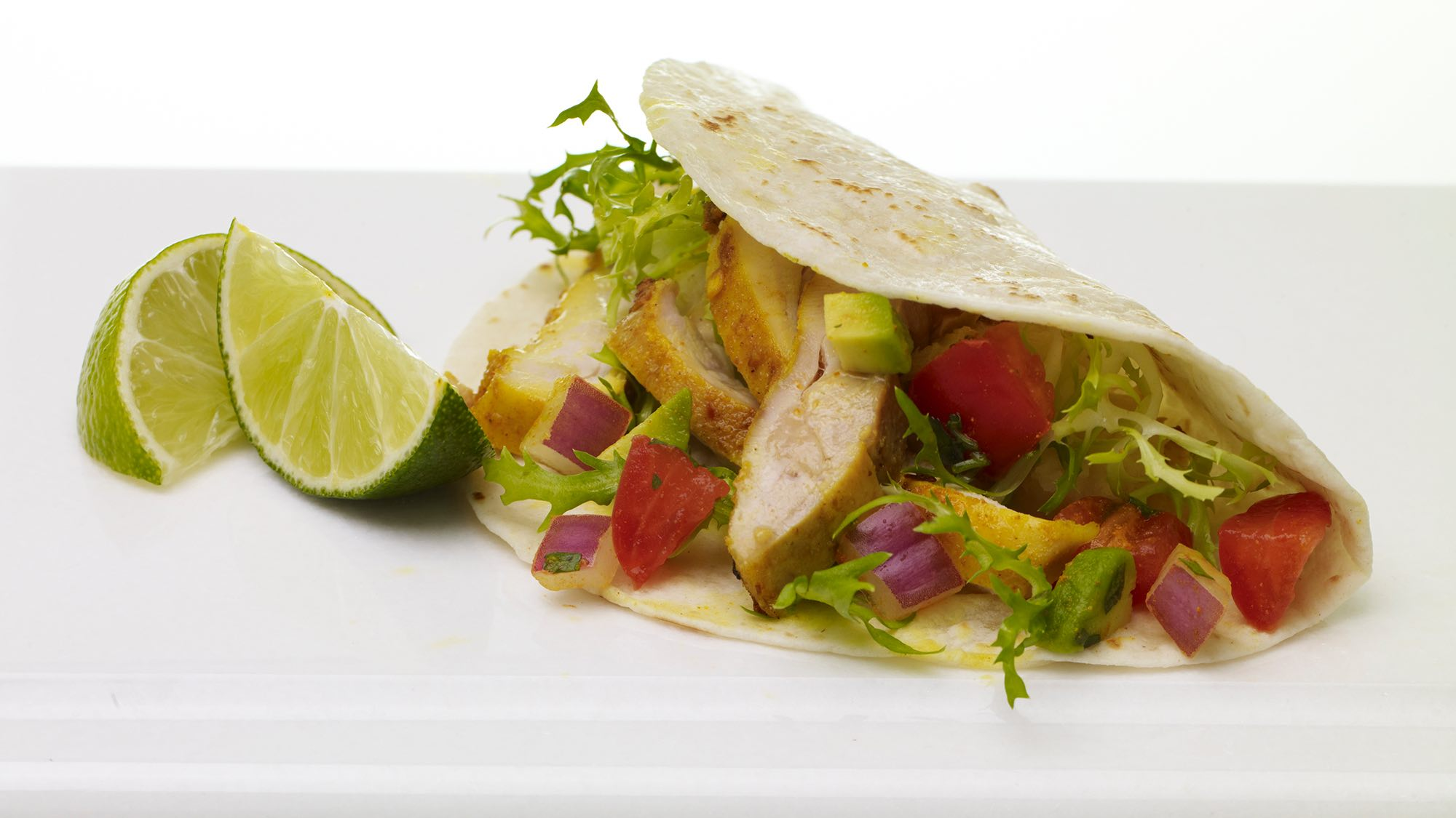 McCormick Turmeric Chicken Tacos with Tomato Avocado Salsa