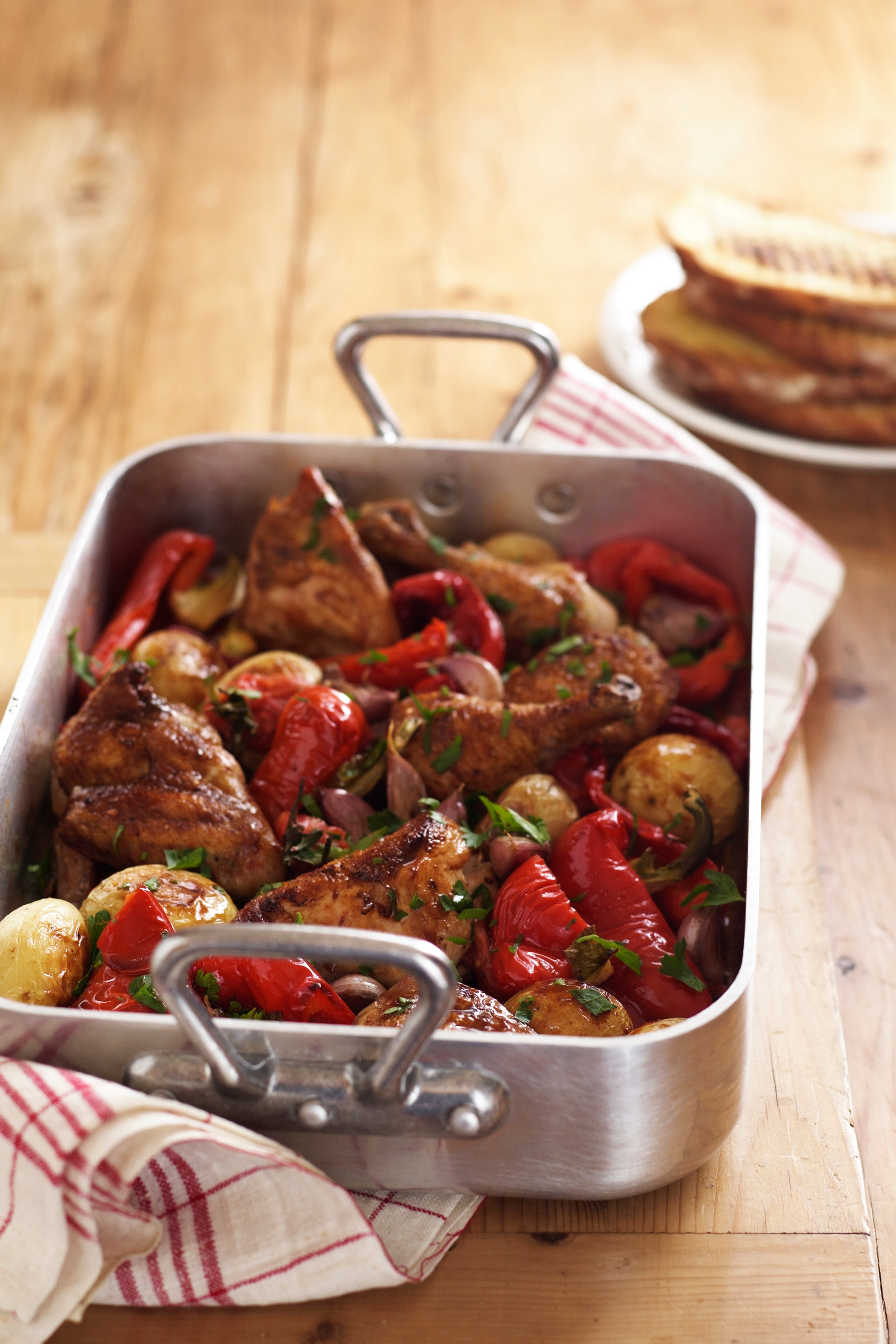 Roast chicken and vegetables in roasting tin