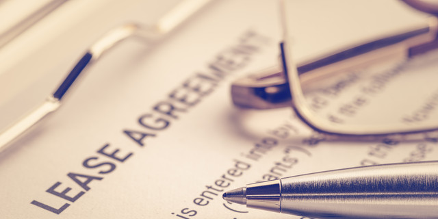 Business legal document concept : Pen and glasses on a lease agreement form. Lease agreement is a contract between a lessor and a lessee that allow lessee rights to use of a property owned by lessor