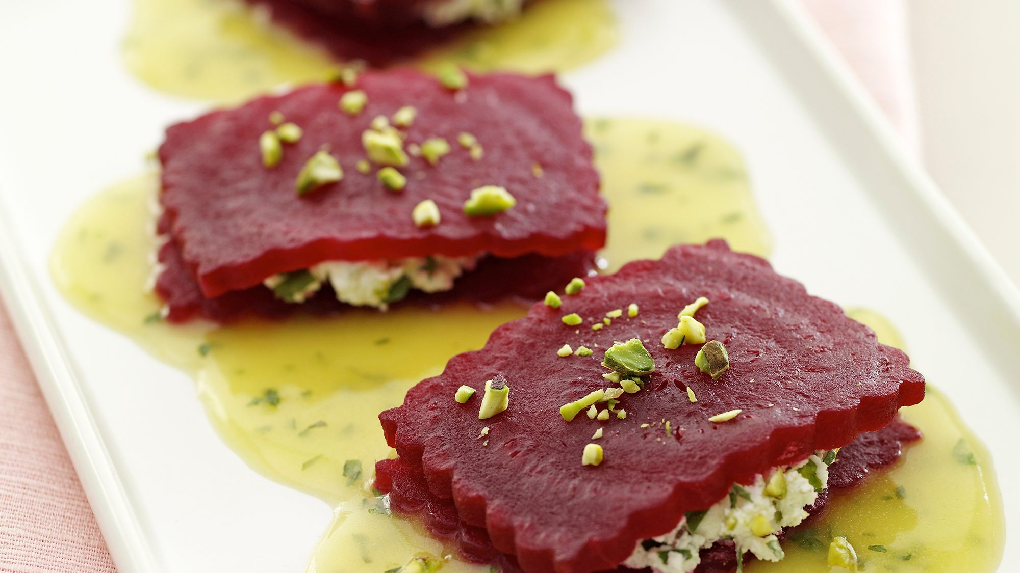 McCormick Gourmet Goat Cheese Beet Ravioli with Tarragon Orange Sauce