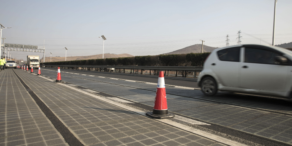 Vehicles travel on photovoltaic lanes developed by Qilu Transportation Development Group Co. on a highway in Jinan, China, on Friday, March 9, 2018. About 45,000 vehicles barrel over the 1,080-meter-long (3,540-foot-long) section every day, and the solar
