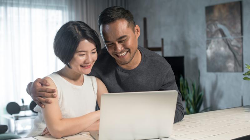 Asian Couple Using Laptop