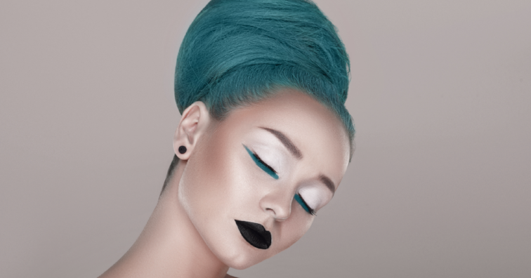 creative and futuristic look of fashion woman with green hair
