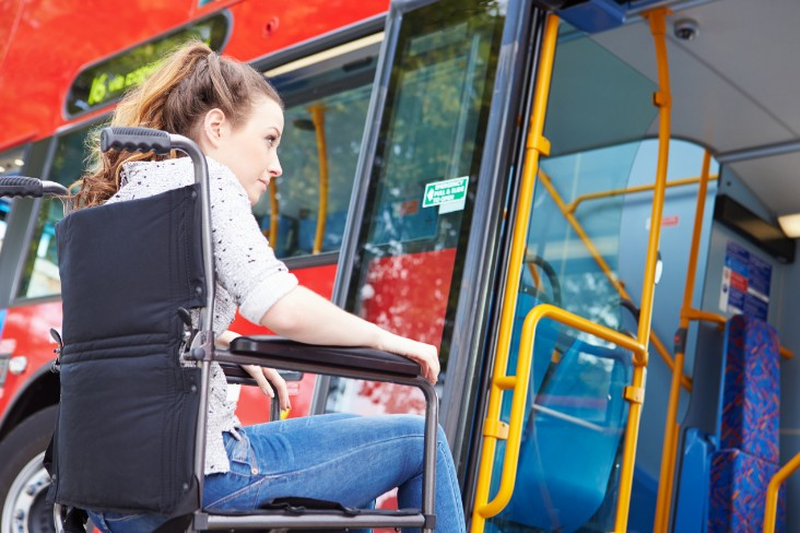 Wheelchair user boarding bus