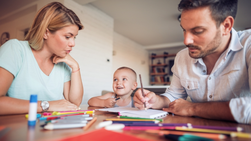 Young parent drawing with their little son.jpeg