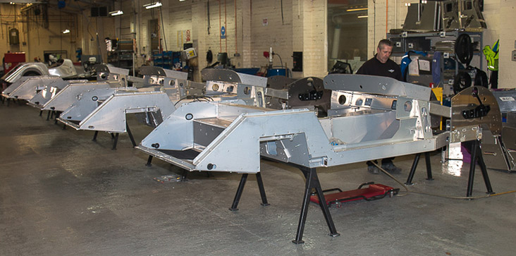 Aluminium panels are attached to the frame of the vehicle
