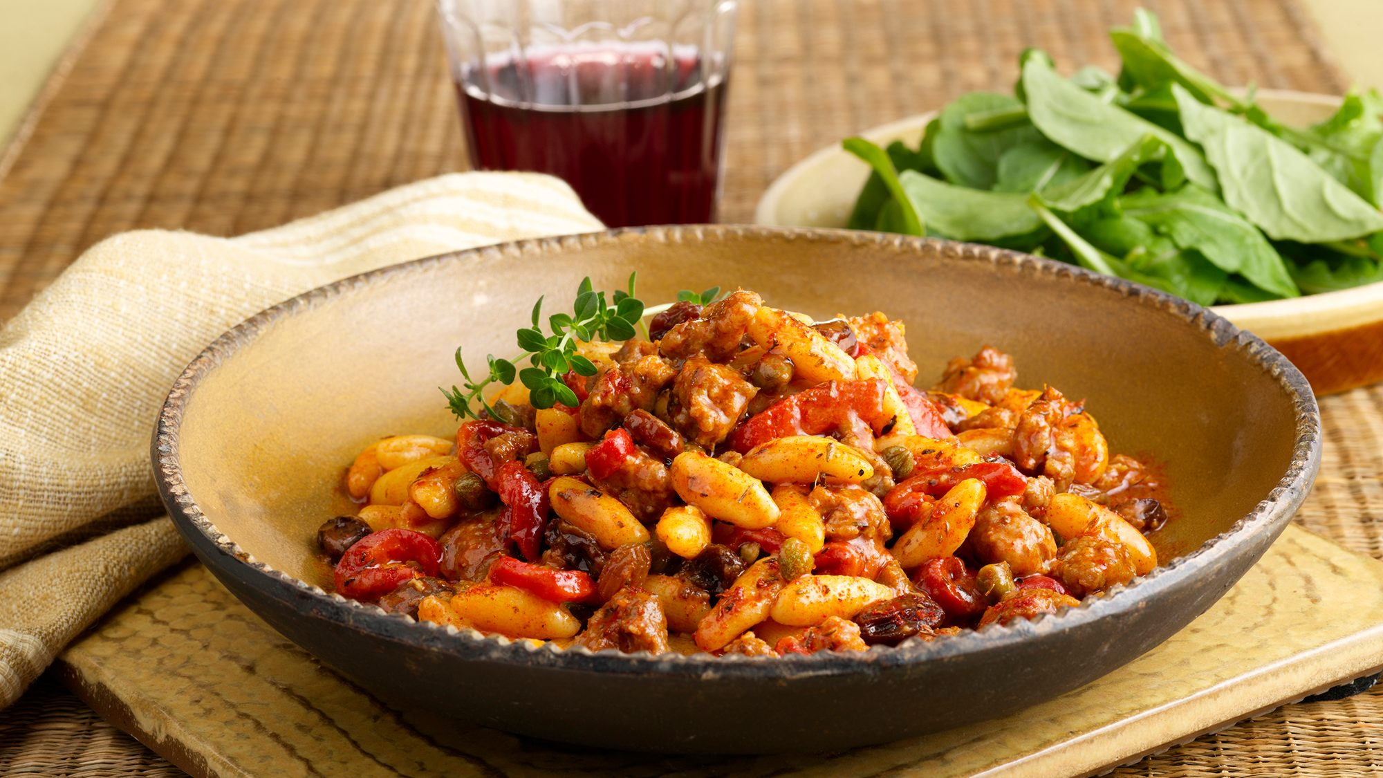 cavatelli-pasta-with-sweet-sausage-roasted-peppers-and-raisins.jpg
