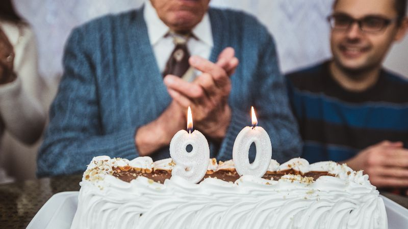 Elderly man celebrates birthday with family