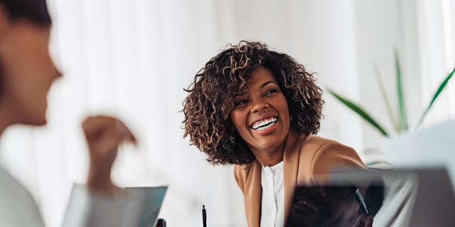 Portrait of cheerful businesswoman smiling at the meeting