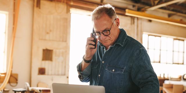 Senior male carpenter working in his workshop