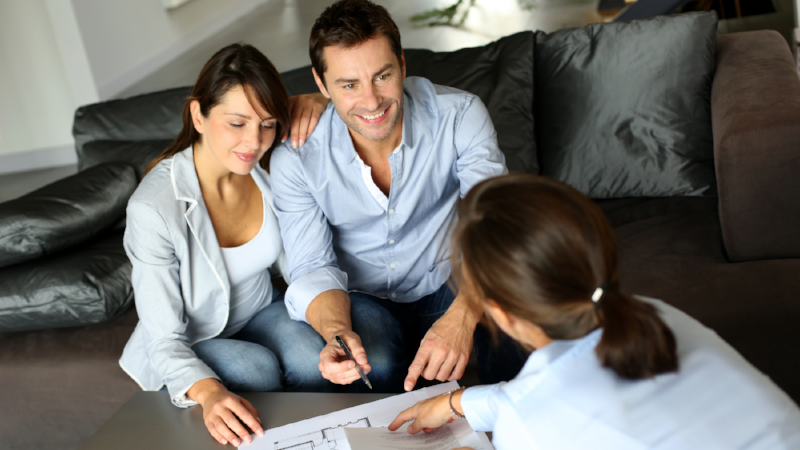 Couple meeting adviser for property purchase