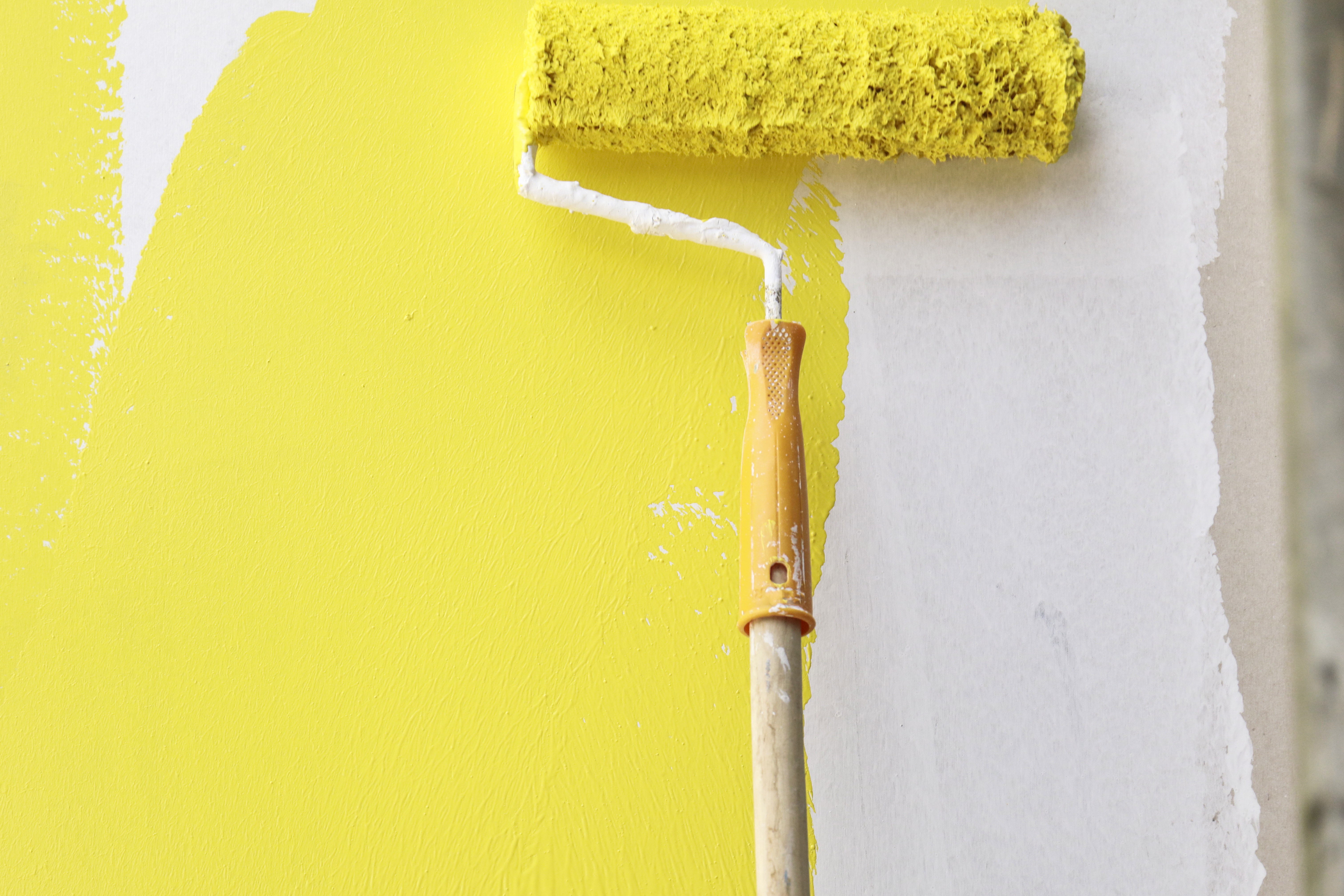 Painting with paintbrush yellow and white