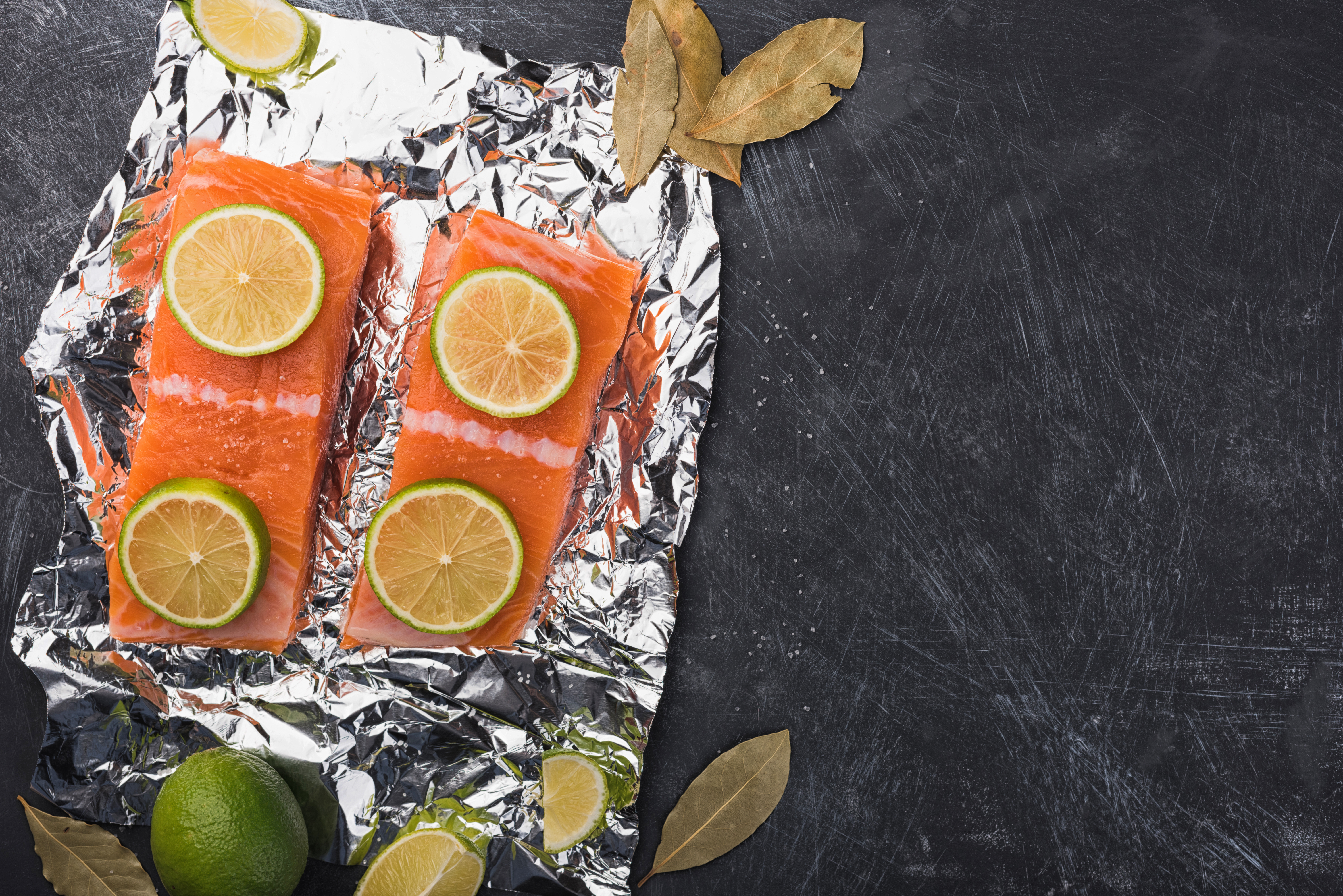 Sliced salmon fillet on a foil.