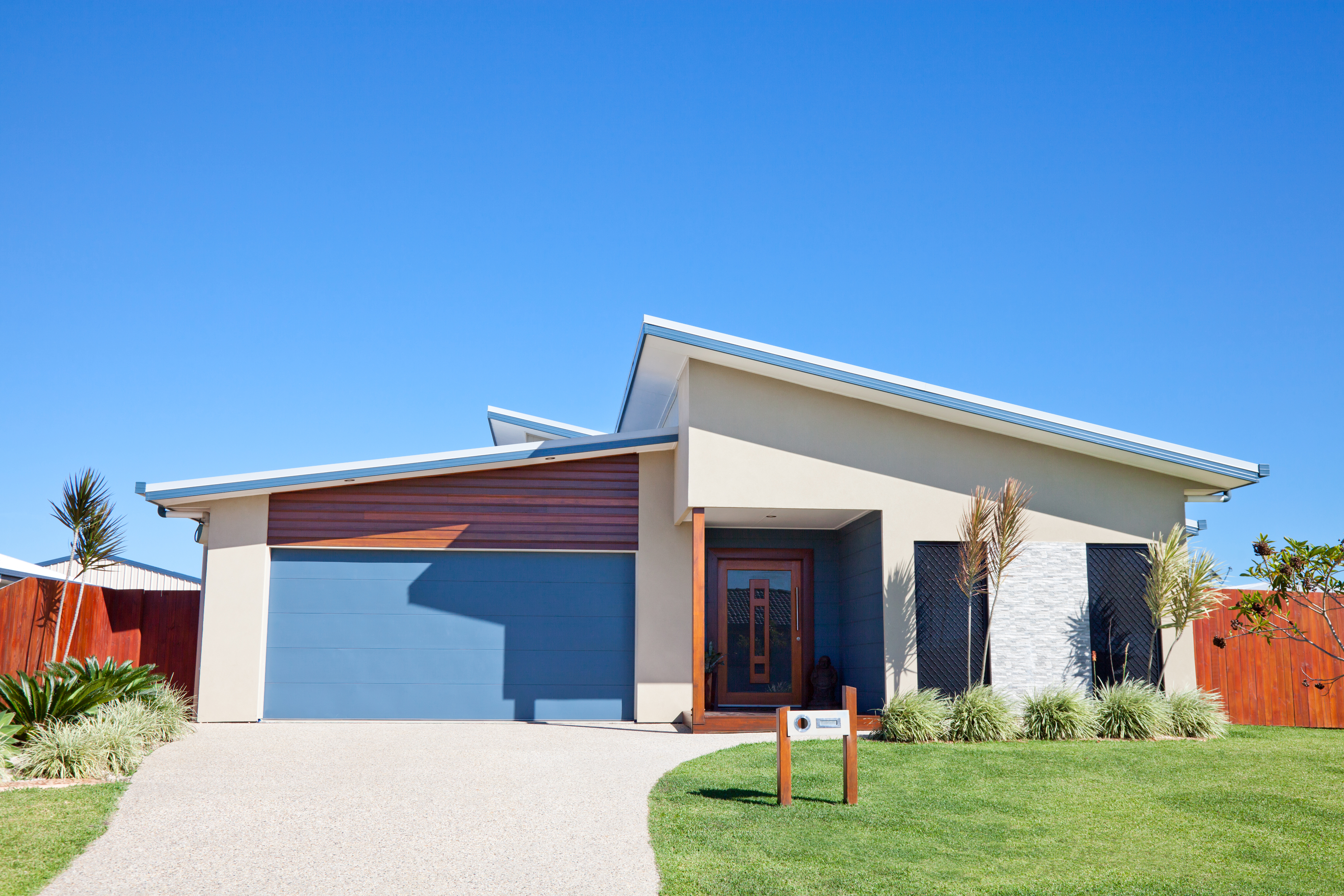 Modern Family Home Front with blue sky copyspace