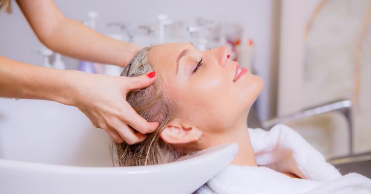 Hairdresser washes head girl
