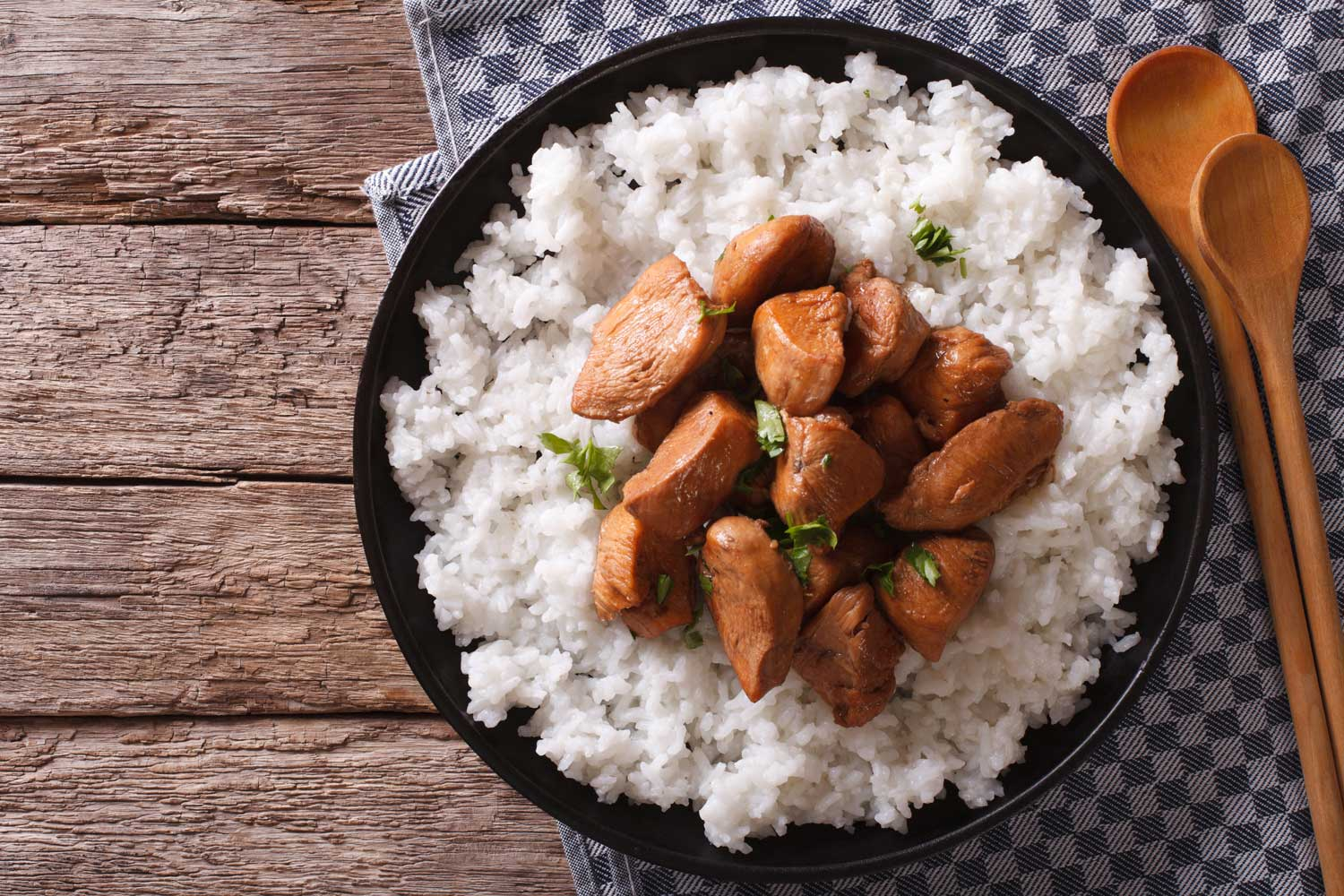 Seasoned Chunks of Meat Over a Bed of White Rice