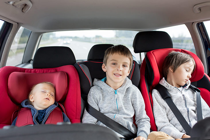 Children in back seat of car