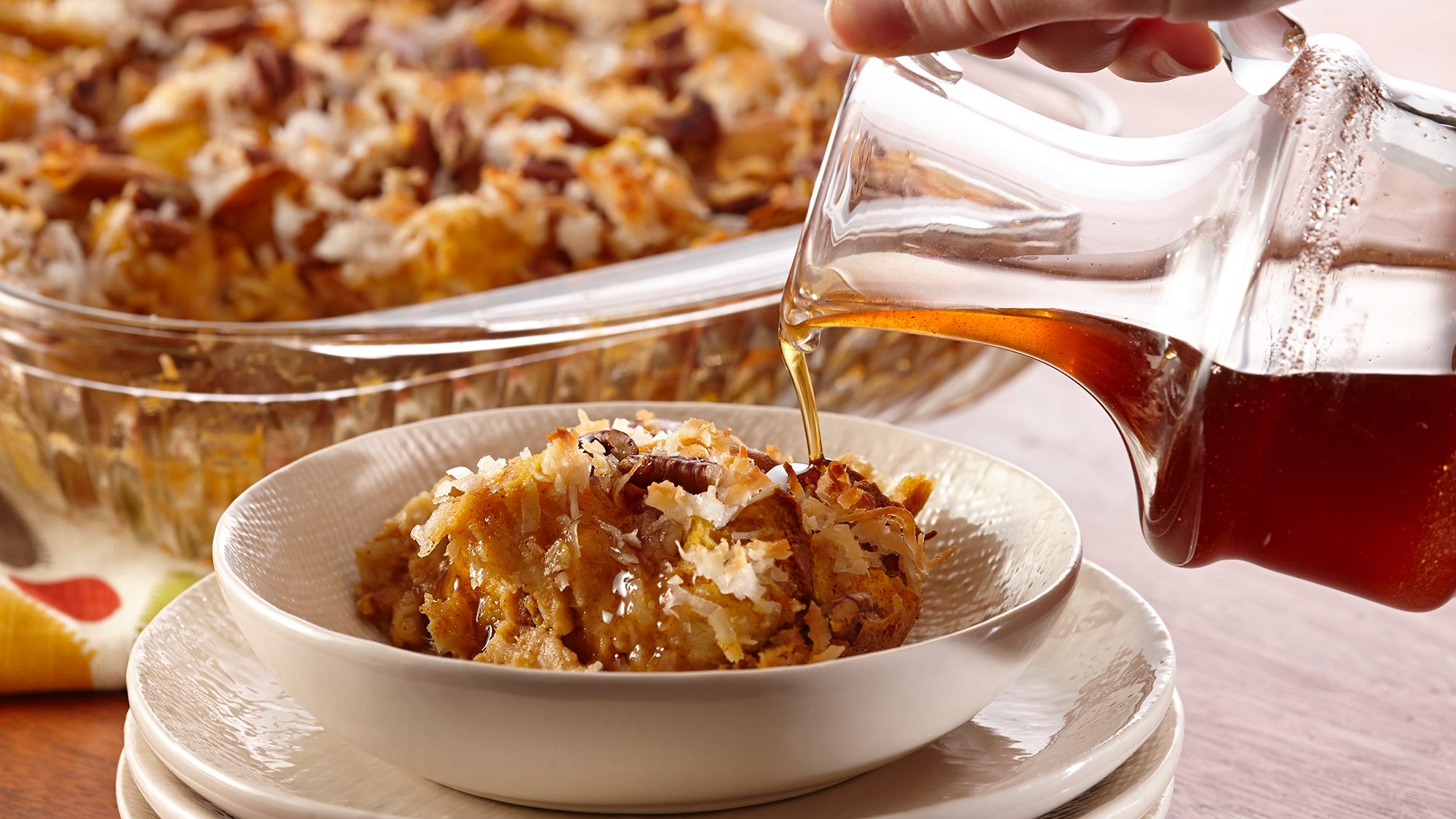 McCormick Coconut Pumpkin Bread Pudding with Spiced Maple Syrup