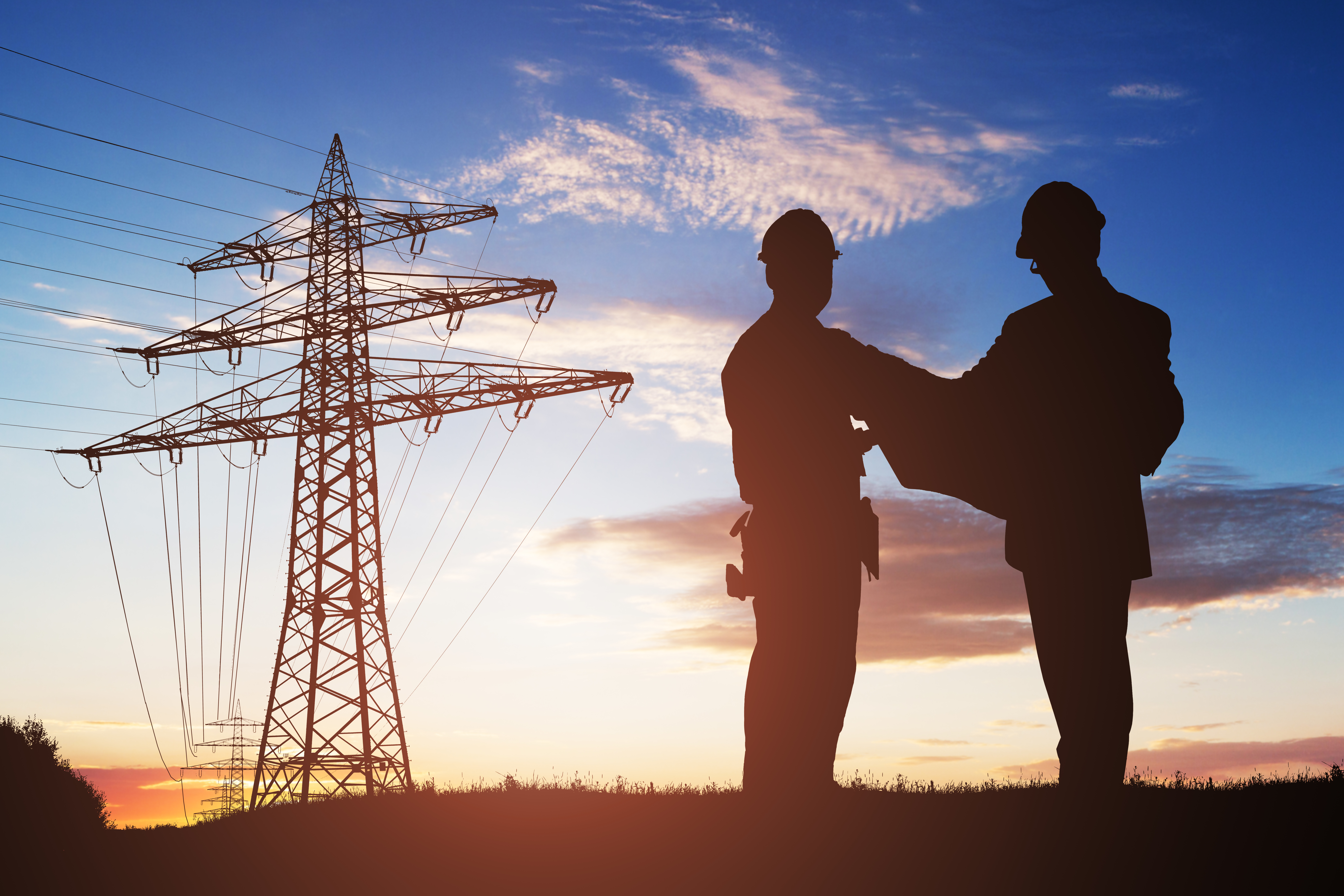 Silhouette Of Two Engineers Discussing Together