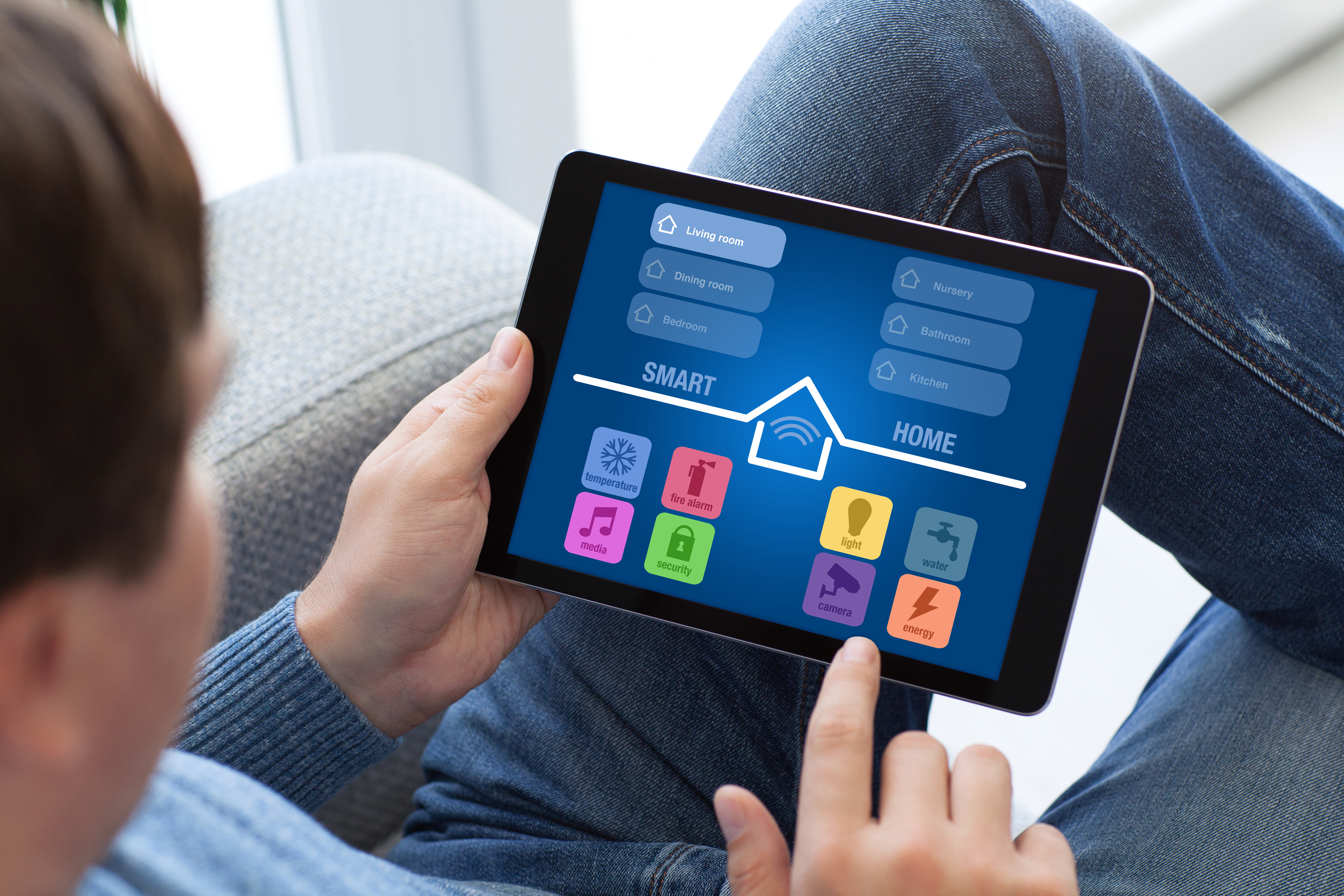 Man views his smart hub on a tablet device