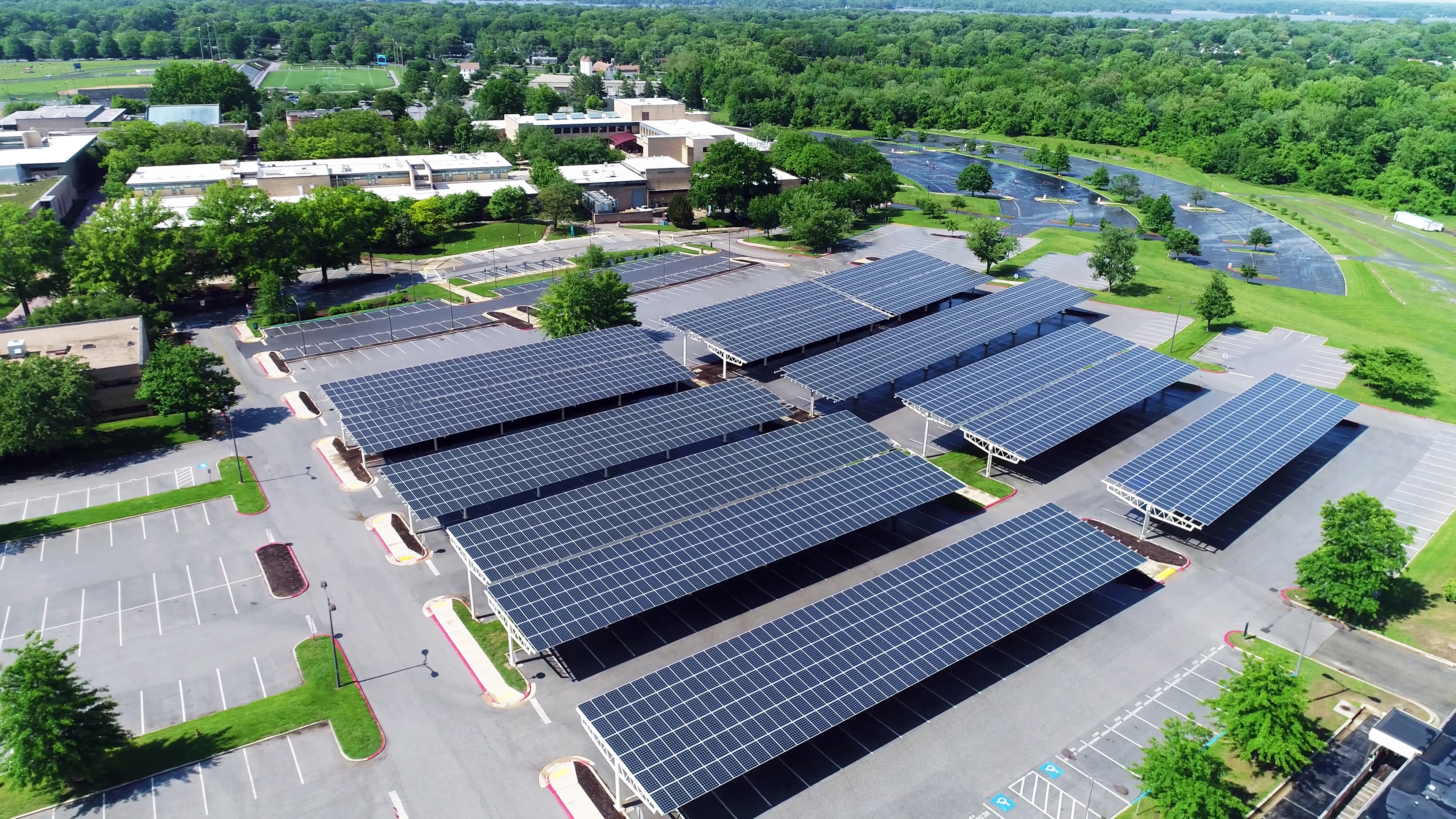 aerial view of solar panels installed in roof of parking