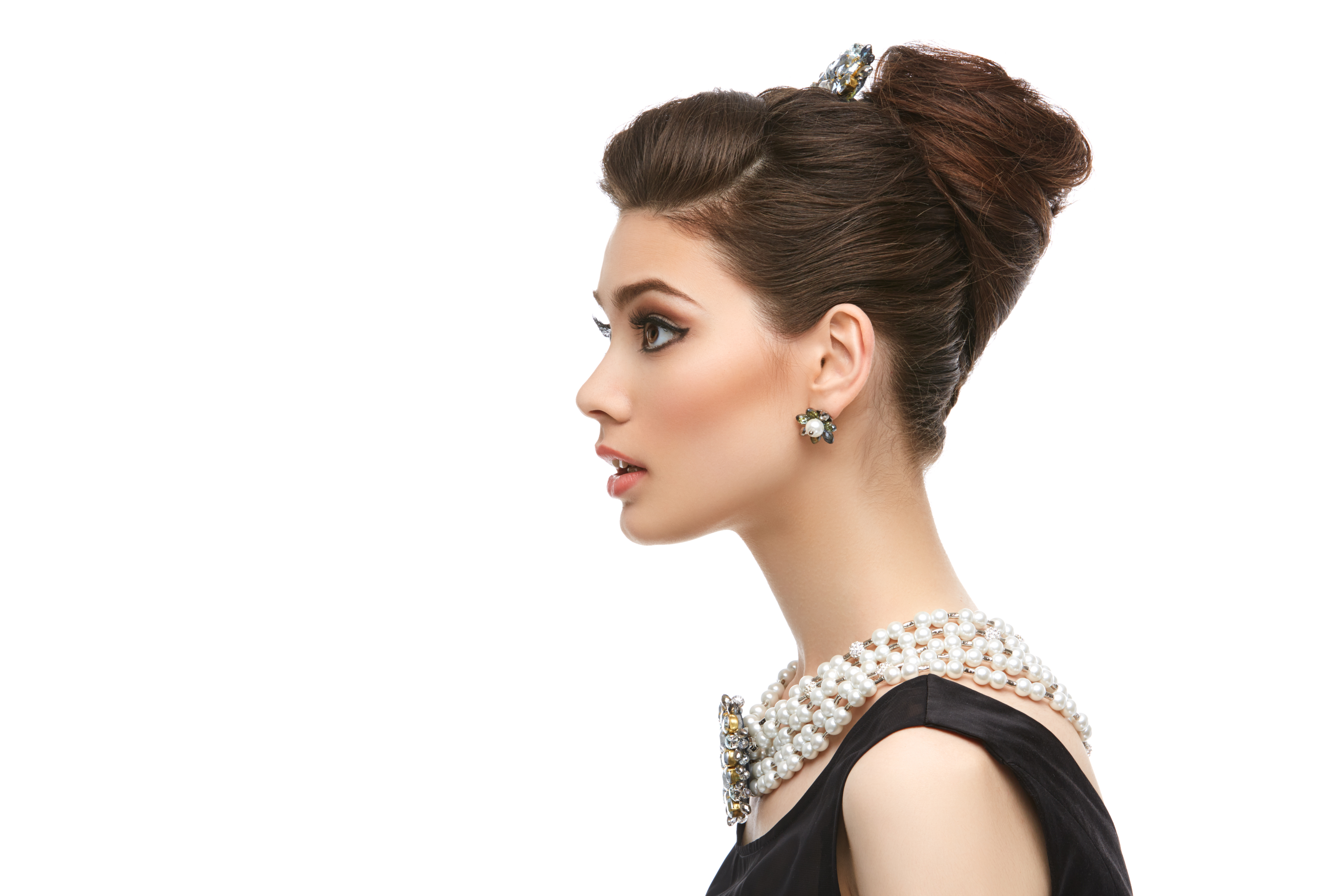 side profile of a woman with an updo hairstyle.jpeg