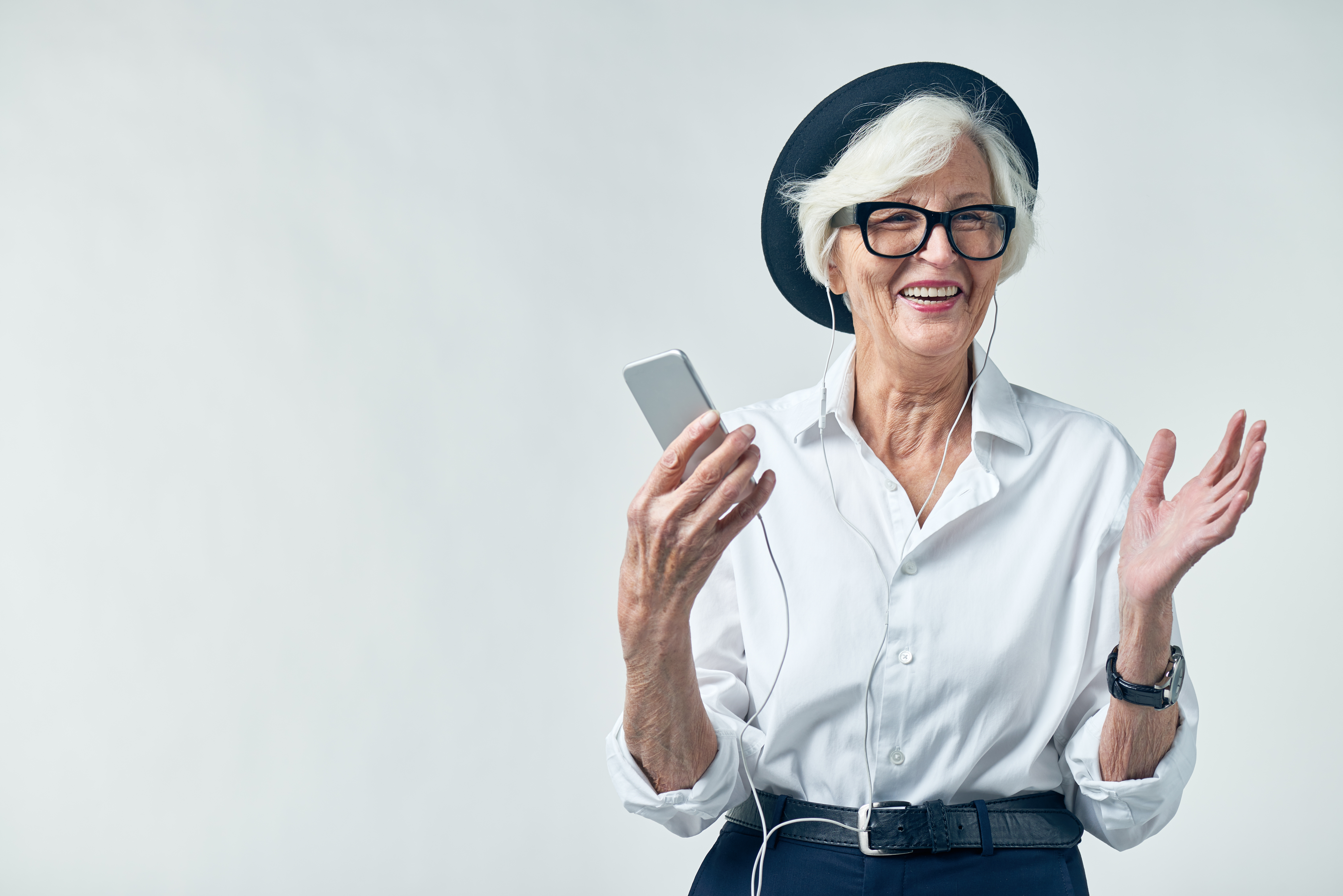 Portrait of elderly woman in hipster clothes